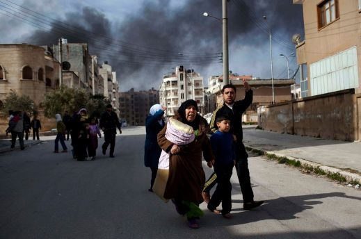 Part of the reason Syria's war has been so devastating is the intense fighting inside densely populated cities. The above photo, part of a Pulitzer Prize–winning collection from 2012, shows what that looks like in practice — a family in the city of Idlib fleeing from the violence overtaking their city. (AP Photo/Rodrigo Abd)