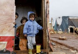 Of the roughly 4 million Syrians made international refugees by the conflict, the overwhelming bulk are living in neighboring countries, particularly Lebanon and Turkey. They're often stuck in hastily constructed and poorly funded refugee camps — like these children in an unofficial refugee camp in Jbaa, Lebanon, in late 2014. (Anwar Amro/AFP/Getty Images)
