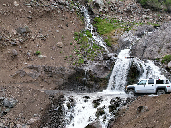 The Spring Thaw cascades over many parts of the road to the summit.