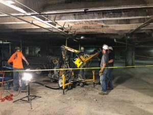 Construction workers removing concrete debris