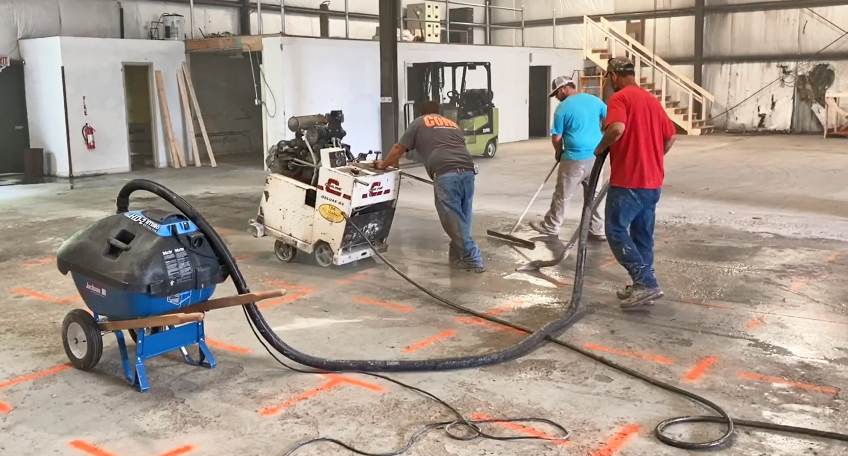 One Roll-n-Vac keeps up with concrete saw; equal to two wet/dry vacs.