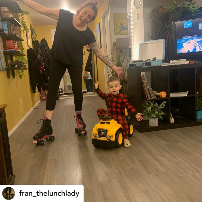 woman on rollerskates next to toddler