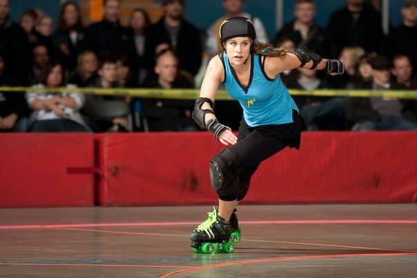 BiznessTime jamming in a Bad Reputations uniform under her old skate name