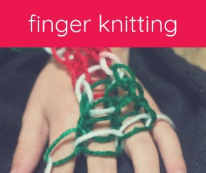 child's hand with yarn knitting