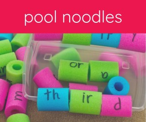 cut pool noodles with letters written on them