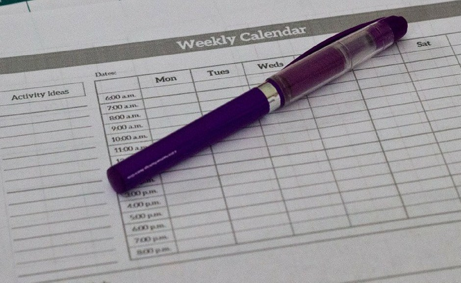 Two calendars with a purple pen