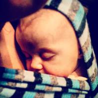 baby in a wrap, sleeping