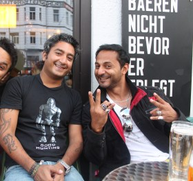 (L-R) Formerly of Jalebee Cartel, producer Ash Roy from Delhi and Mumbai-based DJ and event promoter Nikhil Chinapa take in the lager and lights of Berlin