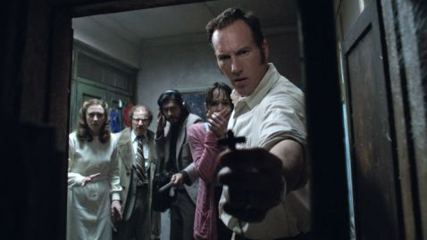 Vera Farmiga, left, and Patrick Wilson, far rigtht, in the haunted-house movie sequel 'The Conjuring 2.'