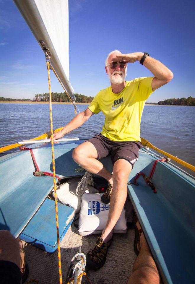 Bill driving the sailboat on the river