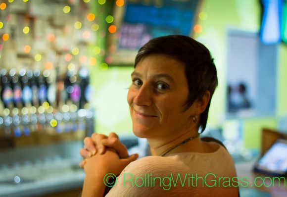 Kate praying at the taproom atlar at o'connor brewing norfolk va rolling with grass oct 2014