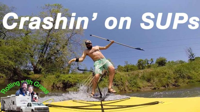 stand up paddle board crashing rolling with grass