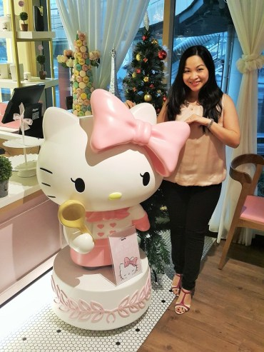 Taking a quick picture with Hello Kitty