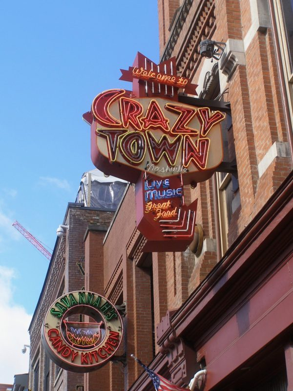 Crazy Town sign on Honky Tonk Highway in Nashville