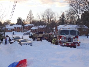 firetruck getting towed out of snowbank