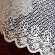 1826 scalloped border on cotton netting.