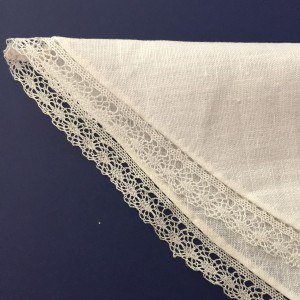 Hand sewn linen fichu folded in half.
