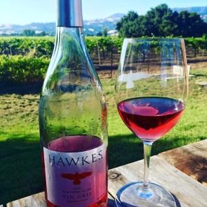 At a picnic table at Hawkes Winery.