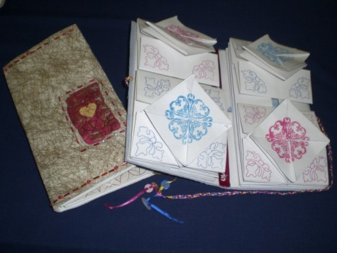 Made by Lori, on the right shows how books open into compartments
