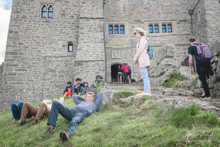 Tourists enjoying the view outside the castle