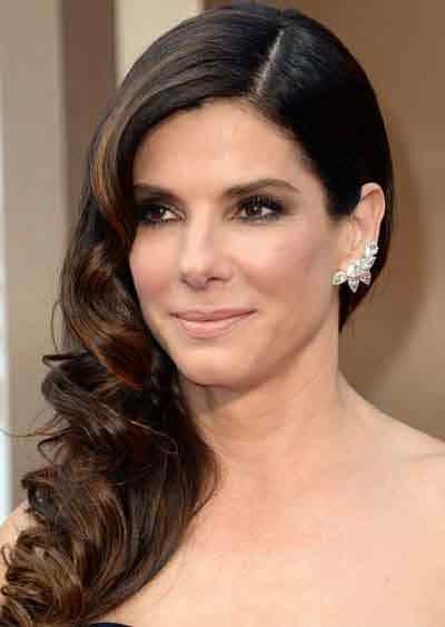 The Best Mid Length Haircuts For Women Over 50 Tresses Wavy Pictures