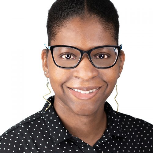 A black woman working as an IT have her headshots in Queens and Brooklyn taken