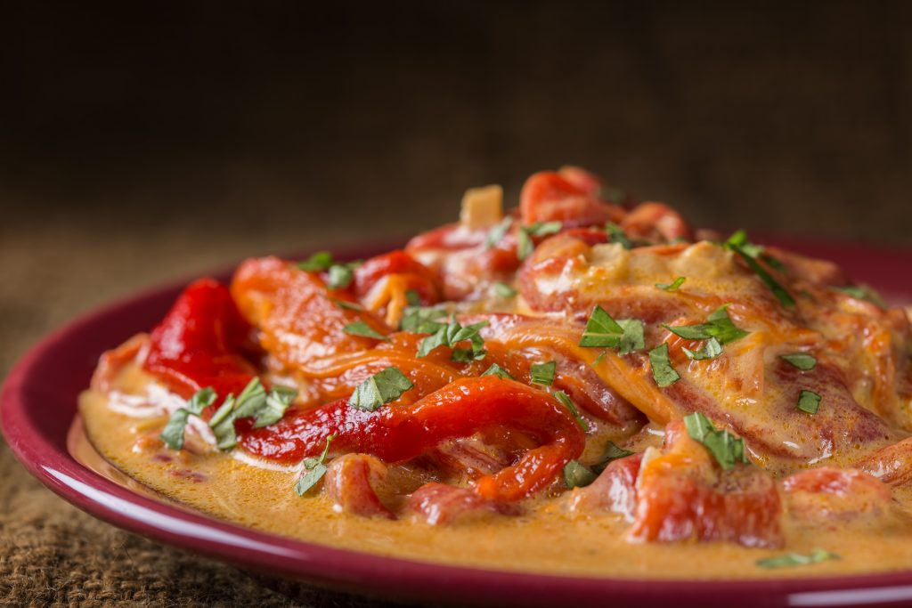 stew made from backed red peppers with sour cream 4GFXH79
