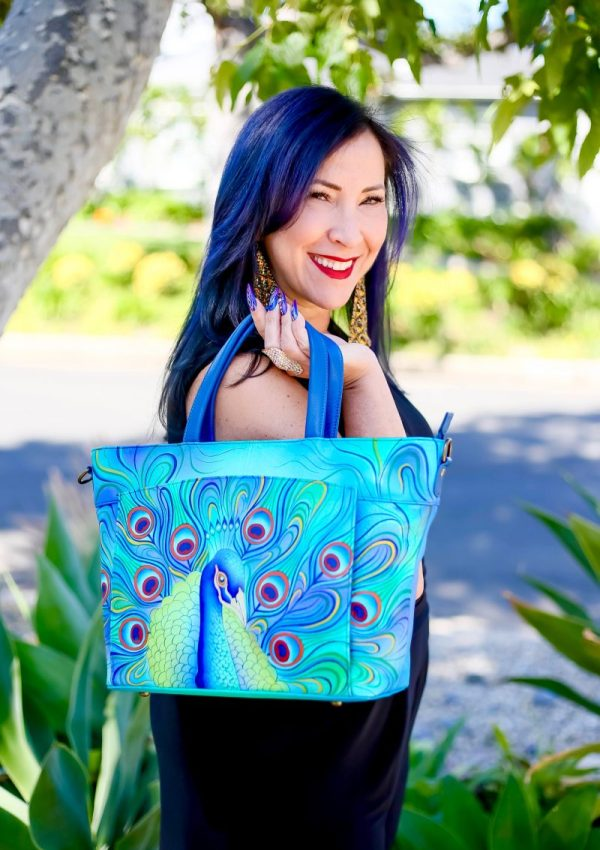 I love making a bold fashion statement in order to standout in a crowd and Anuschka's unique hand painted accessories make a beautiful and colorful impression.