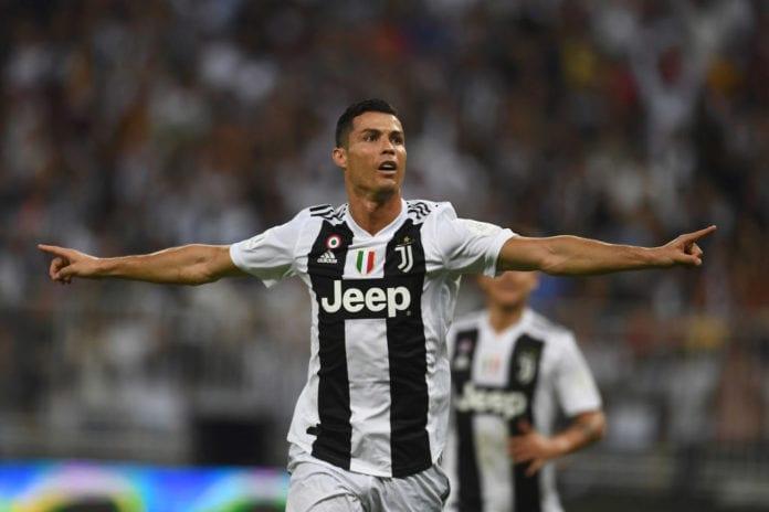 Cristiano Ronaldo celebrates with Floyd Mayweather