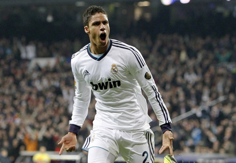 MADRID, SPAIN - JANUARY 30: Raphael Varane of Real Madrid celebrates after score during the Copa del Rey Semi-Final first leg match between Real Madrid CF and FC Barcelona at Estadio Santiago Bernabeu on January 30, 2013 in Madrid, Spain. (Photo by Angel Martinez/Real Madrid via Getty Images)