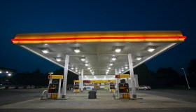 Gas Station with lights on and mini-mart at dusk in Central GA