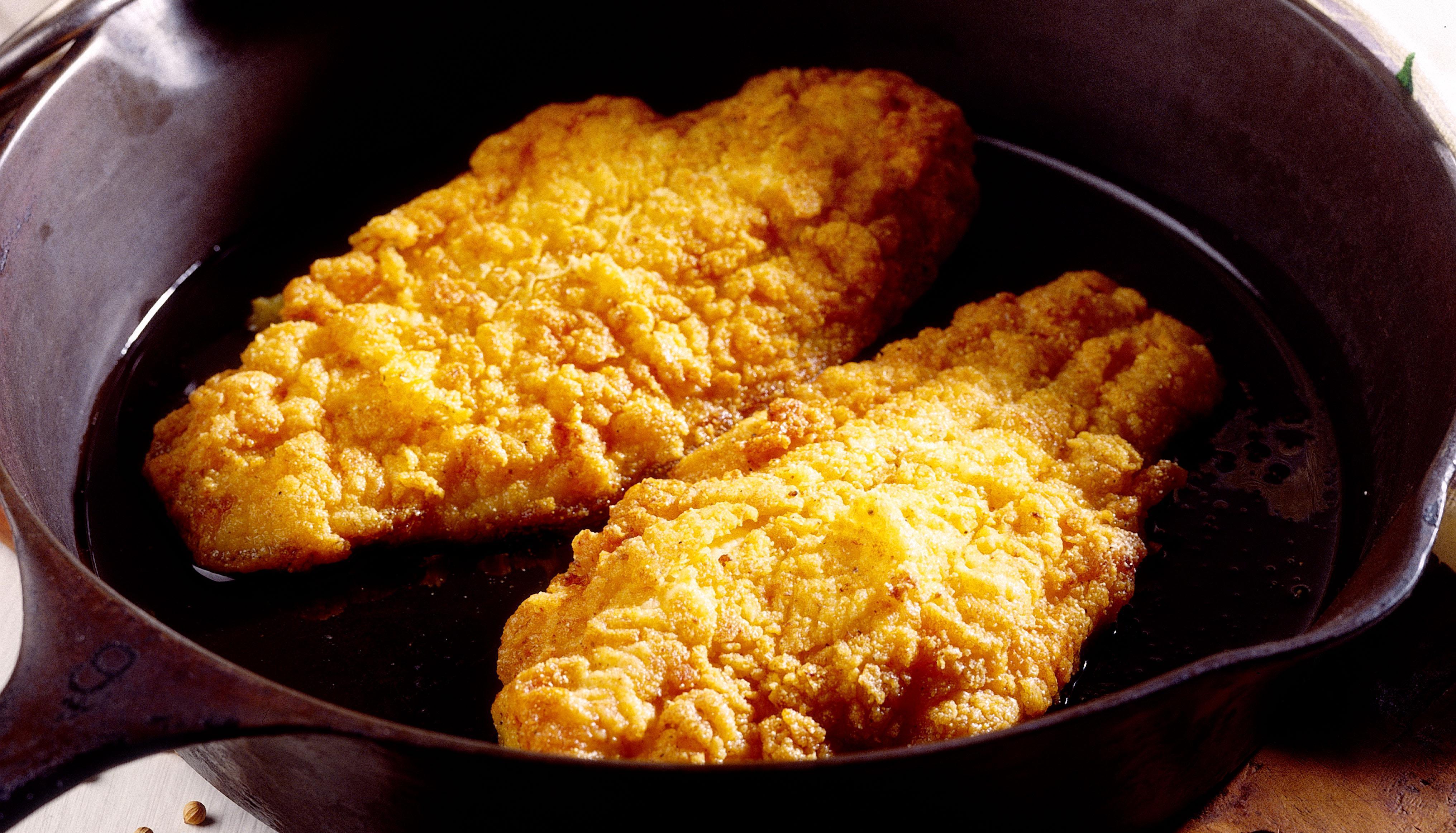 Fried catfish in skillet