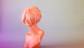 Mannequin Head Hiding Behind Blonde Wig