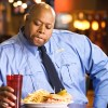 Black police officer eating unhealthy food