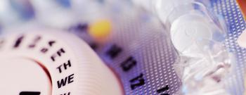 Birth control pills in plastic tablet dispenser case