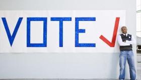 Man standing with vote sign