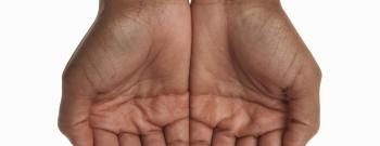 Young woman cupping hands, close-up of hands