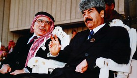 Iraq––The late King Hussein of Jordan with Saddam Hussein at the Iraqi military parade grounds in a