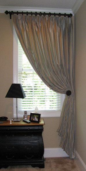 bedroom with single panel drape
