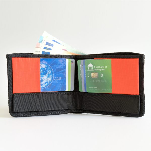 Cordura version of the RONKER Wallet in orange, open, filled with bills and cards