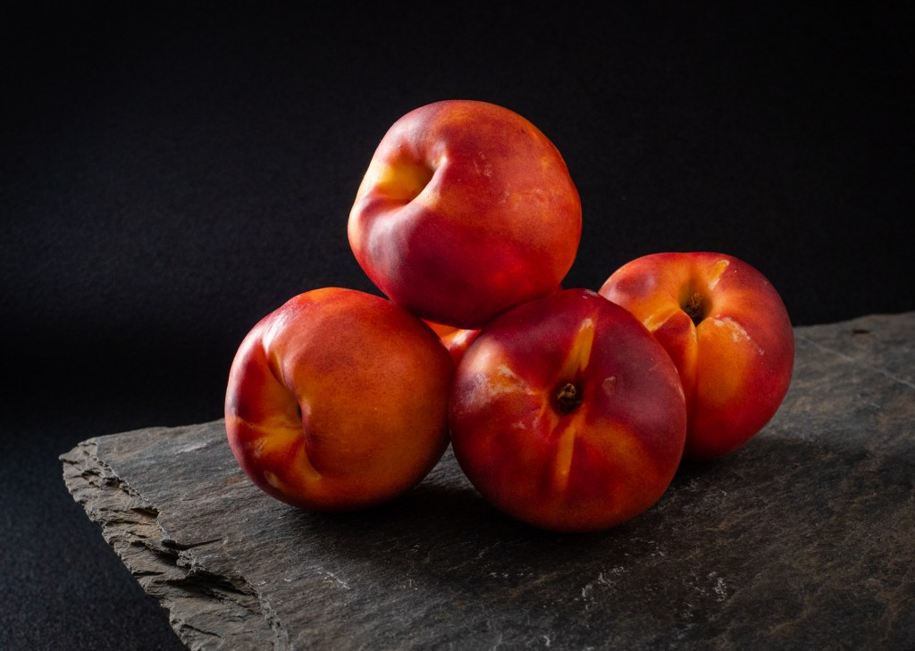 Still Life with Nectarines on antique roof slate