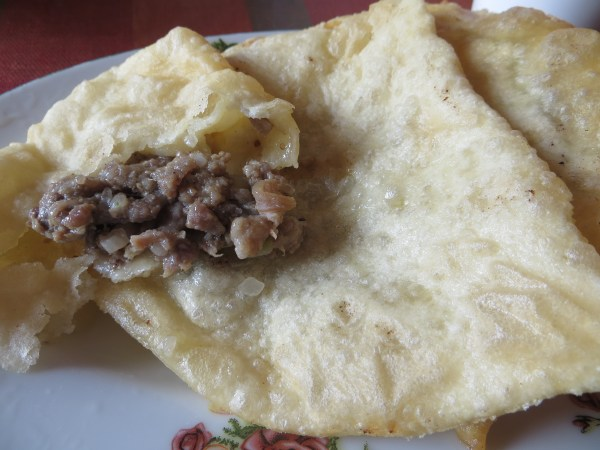 Traditional Naadam food, khuushuur - fried mutton pancakes