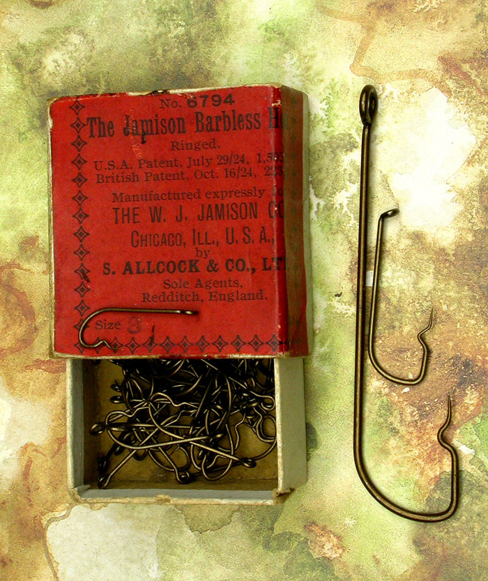 """10. The Jamison Barbless Hooks, #6794, #8, bronzed, ringed. USA Patent, July 29/24 1,502781, British Patent, Oct. 16/24, 223,137. Manufactured expressly for The W Jamison Co., Chicago, Ill., USA by S Allcock & Co., LTD.. Sole Agents, Redditch, England. Hooks in the box are about 13/16"""" long."""