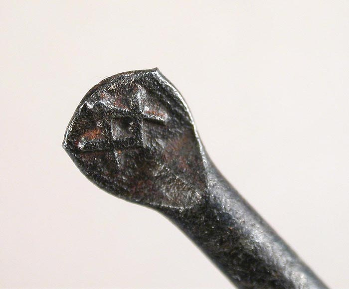 """22c Clerk, Green & Baker hook with a Mason's symbol on the flat and the name embossed on the bottom of the shank. There is no place of manufacture on the hook. Hook is about 3 ¾"""" long and a gape of about 1 1/8"""" directly above the point. This hook and #33 are almost the same length, the bends are virtually identical and except for the slight upturn in the shank and slightly lower point, one could surmise they came from the same hook shop. I am not saying they were but hook companies did private label hooks back in the day. See more on this hook in the English Hooks Section."""