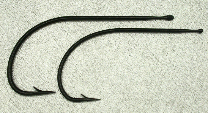 W Woodfield & Sons, two sizes, knobbed, Kinsey, japanned. The largest hook is the same as #24. These were a gift of Paul Rossman.