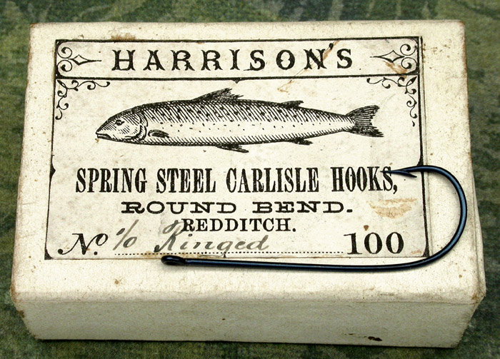 "9a Harrison's, #1/0, round bend, blued, ringed straight eye, Carlisle hooks, 1 3/8"" long, Redditch England."