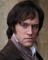 Elliot Cowan als Darcy