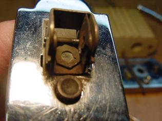 Disassembled mechanism showing the frozen flint