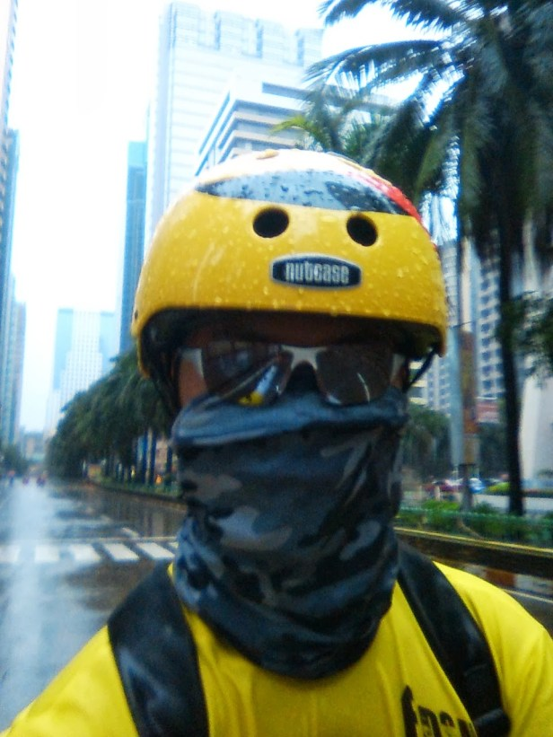 biker wearing yellow Nutcase helmet and balaclava