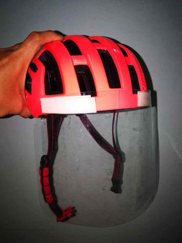 DIY face shield mounted in front of bike helmet